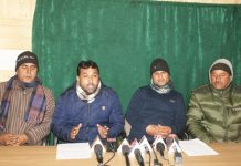 Drainage Circle daily wagers holding press conference at Srinagar. -Excelsior/Shakeel