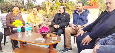 Trustees of Dharmarth Trust during a meeting at village Arjai on Thursday.