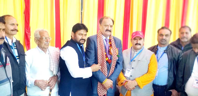Former Minister Surjeet Singh Slathia and community leaders posing for group photograph.