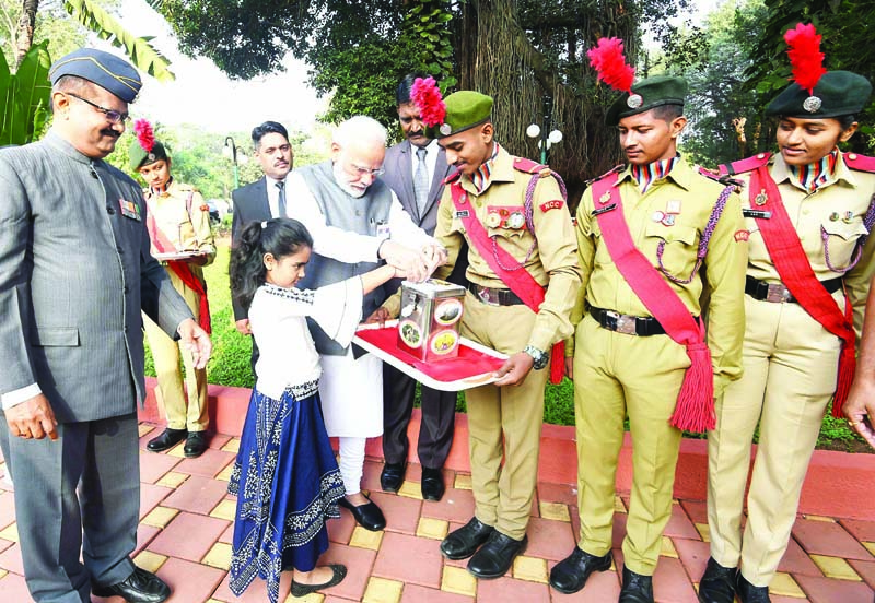 Prime Minister Narendra Modi makes a contribution for the welfare of Armed Forces, on the occasion of the Armed Forces Flag Day, in Pune on Saturday. (UNI)