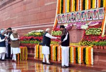 Prime Minister, Narendra Modi paying floral tributes to the martyrs of the 2001 Parliament attack, at Parliament building, in New Delhi on Friday.