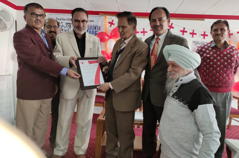 Members of Indian Red Cross Society J&K chapter during celebration of International Volunteer Day in Jammu on Thursday.