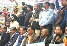 Traders staging protest at Jantar-Mantar in New Delhi on Thursday.