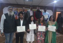Participating artists displaying certificates after a programme for Dogri promotion.