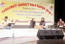 Students presenting item during folk and classical musical evening at Jammu.