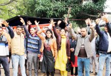 Plus 2 Contractual Lecturers protesting for their regularization. -Excelsior/Rakesh