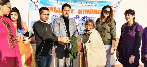 French Club members along with others distributing warm clothes to the poor and needy people at Jammu on Monday.