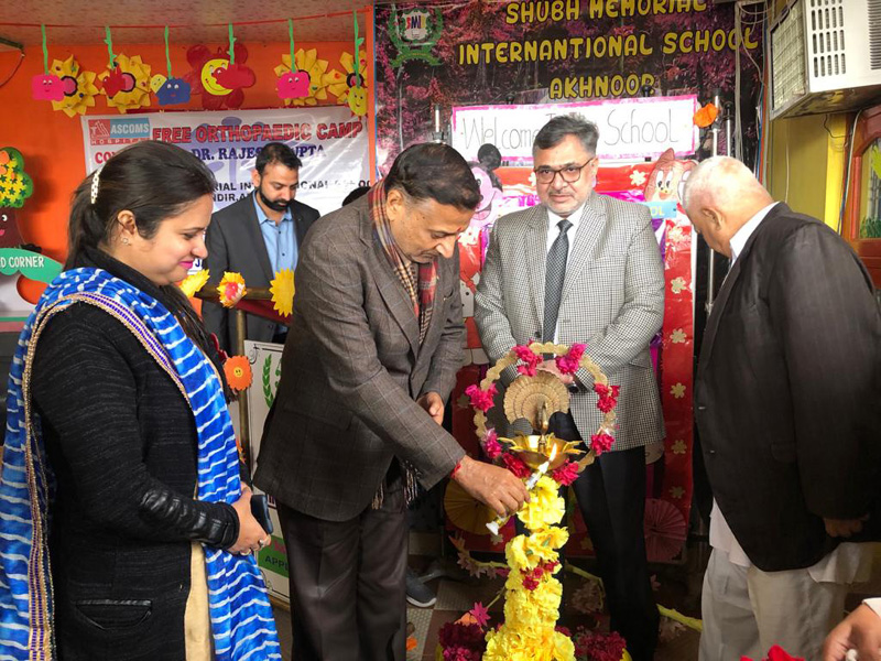 Former Minister, Sham Lal Sharma lighting the lamp to inaugurate a medical camp at Akhnoor on Tuesday.