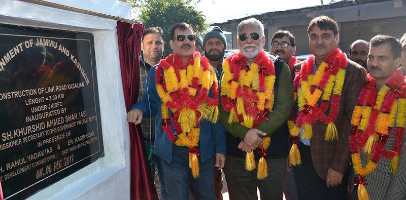 Commissioner Secretary PWD inaugurating link road in Rajouri on Friday.