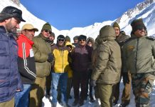 CEC LAHDC Kargil Feroz Ahmad Khan along with senior officers taking stock of snow clearance work on Kargil-Srinagar NH.