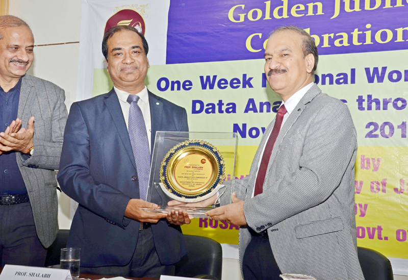 A resource person being felicitated at a workshop in Jammu University on Saturday.
