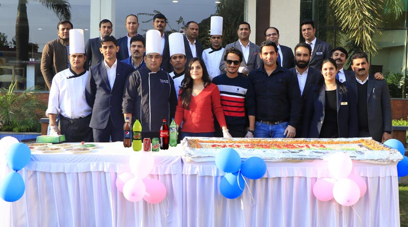 Guests and staffers of Hotel Country Inn & Suites performing cake mixing ceremony at Jammu on Thursday.