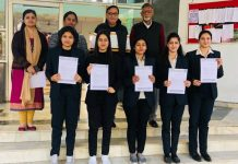 Selected students of IMS Jammu displaying placement letters.