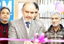 Zonal Head Kashmir (Central I) of J&K Bank Syed Rais Maqbool inaugurating CRM Machine at BU Hari Singh High Street in Srinagar.