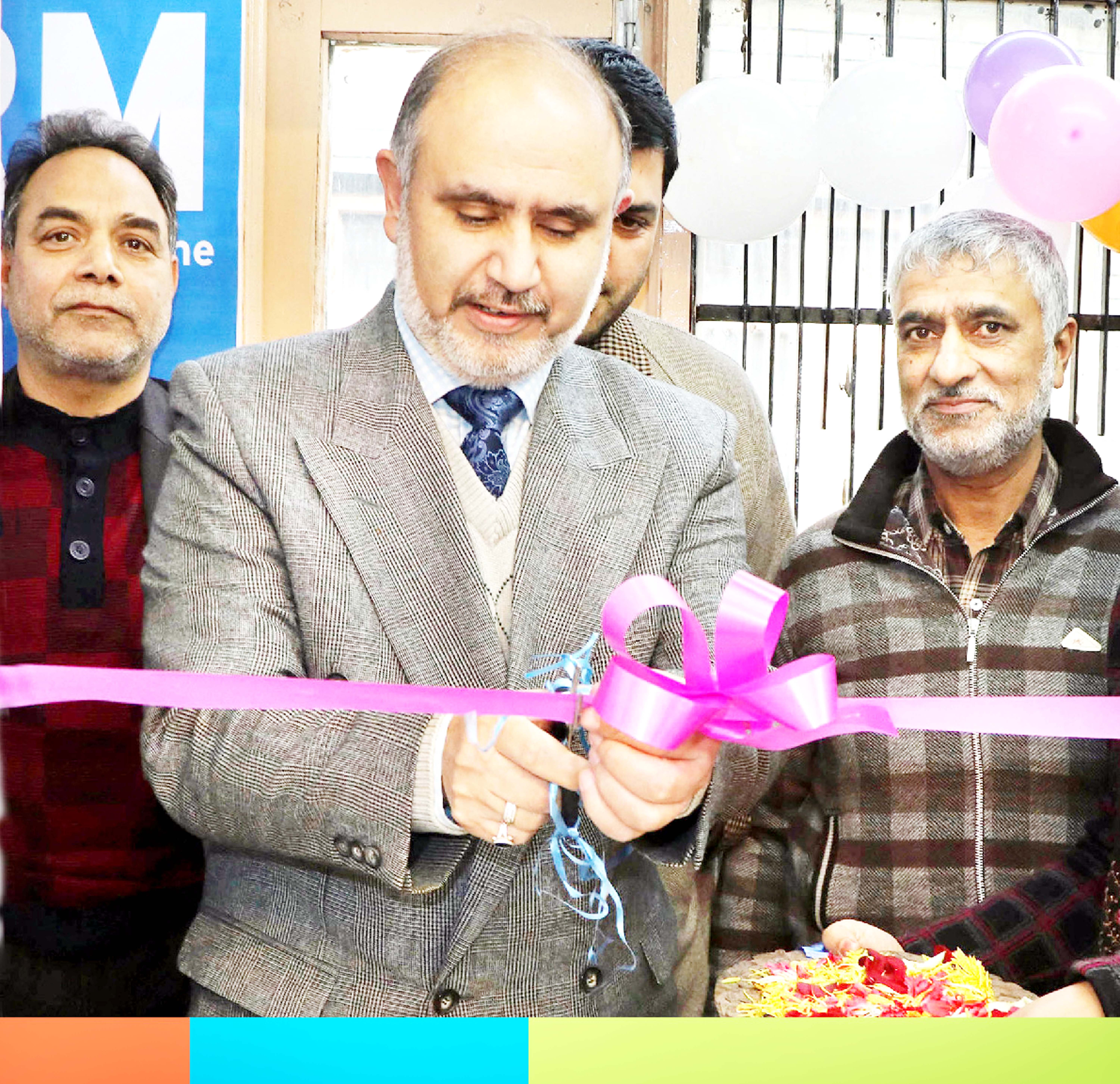 Zonal Head Kashmir (Central I) of J&K Bank Syed Rais Maqbool inaugurating CRM Machine at BU Hari Singh High Street in Srinagar.