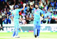 KL Rahul and Rohit Sharma celebrating India's thrilling win against New Zealand at Hamilton.