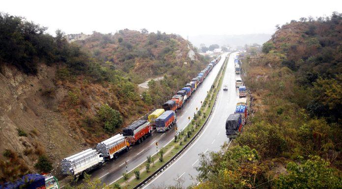 Stranded trucks near Nagrota on Jammu- Srinagar National Highway. -Excelsior/Rakesh
