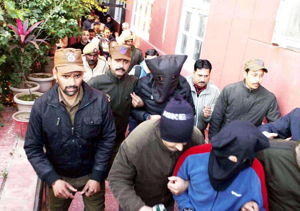 DySP Devinder Singh being produced in the NIA court on Thursday. —Excelsior/Rakesh