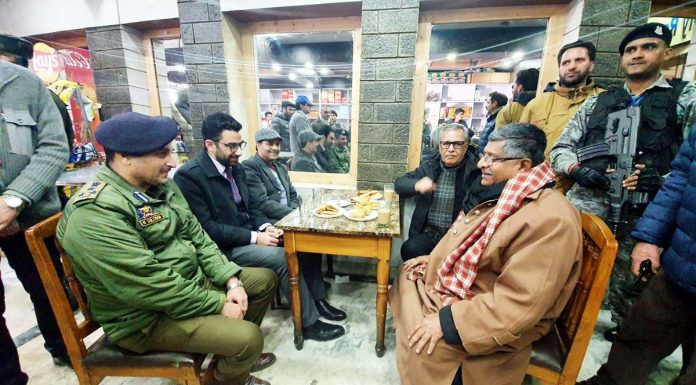 Union Minister Ravi Shankar Prasad enjoys tea at a local restaurant in Baramulla on Thursday. —Excelsior/Aabid Nabi