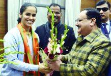 Badminton player Saina Nehwal meet BJP President J P Nadda (R) after they joined Bharatiya Janata Party, in New Delhi on Wednesday.