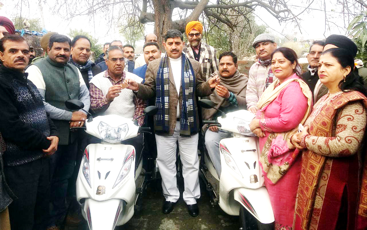 MP Jugal Kishore Sharma giving Scooties to differently abled persons at Miran Sahib.