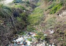 A portion of irrigation canal in Vijaypur area filled with garbage and filth.