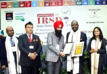 "Dr Rajinder Singh Sodhi, Deputy Director, Aryans Group receiving ""Academic Leadership Award""."