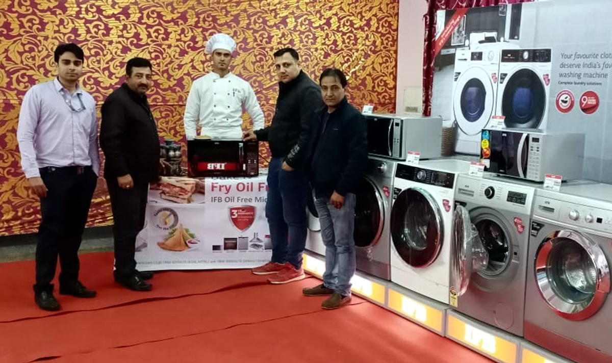 IFB officials showcasing a range of washing machines and microwave ovens to be displayed during exchange mela.