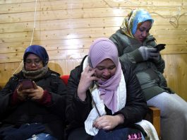 Malaysian tourists turning emotional after they called their families using internet access at media centre in Srinagar. —Excelsior/Shakeel