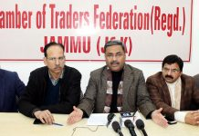 Office bearers of Chamber of Traders Federation addressing press conference in Jammu. —Excelsior/Rakesh