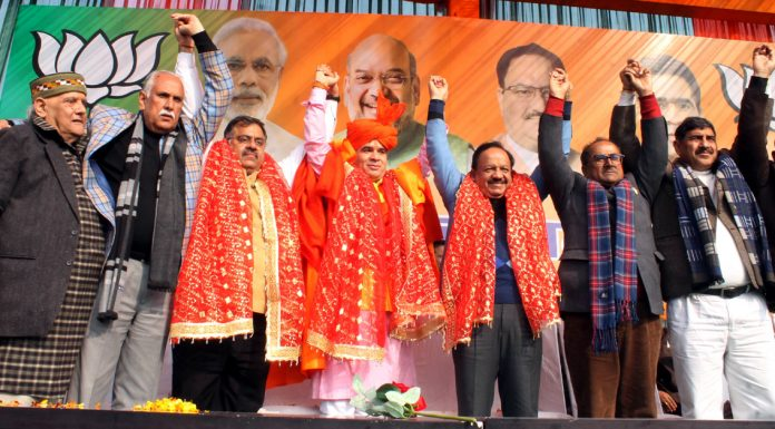 BJP leaders including Union Health Minister Dr Harshvardhan posing with newly elected BJP J&K president, Ravinder Raina during a rally at Jammu on Wednesday. —Excelsior/Rakesh