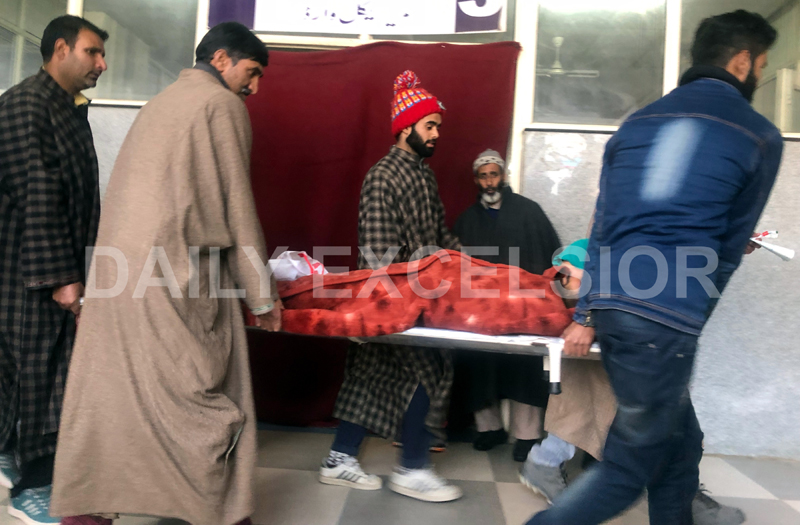 In the absence of lift, attendants carrying patient on a stretcher in District Hospital Baramulla. -Excelsior/Aabid Nabi