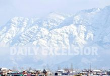 Snow clad mountains at Dal lake in Srinagar. -Excelsior/Shakeel