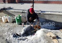 A man lits fire under tap to defreeze it to get water in Leh where temperature remains several degrees below normal. -Excelsior/Morup Stanzin