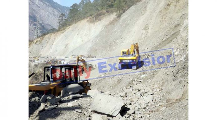 Machines engaged in road clearance work at Digdole in Ramban on Thursday. -Excelsior/Parvaiz Mir