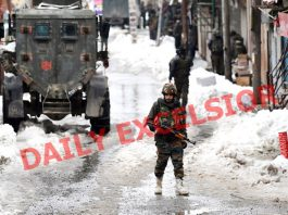 Army personnel move towards a locality at Chadoora in Central kashmir's Budgam district during cordon and search operation on Friday. -Excelsior/Shakeel