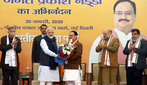 Prime Minister Narendra Modi felicitating newly elected BJP national president JP Nadda at BJP Headquarters in New Delhi on Monday. (UNI)