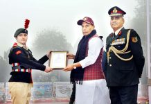 Defence Minister Rajnath Singh presenting Raksha Mantri Padak and Commendation Cards to brave NCC cadets during his visit to NCC Republic Day Camp in New Delhi on Wednesday. (UNI)