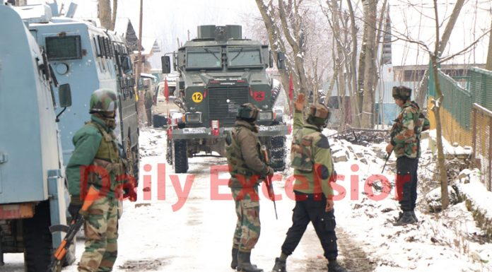 Troops during gun battle in Tral on Sunday. — Excelsior/Younis Khaliq