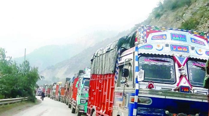 Stranded vehicles being cleared towards Jammu near Ramban on Saturday evening. -Excelsior/Parvaiz Mir