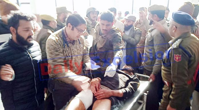 An injured porter being taken to District Hospital Poonch on Friday .-Excelsior/ Gurjitbhajan