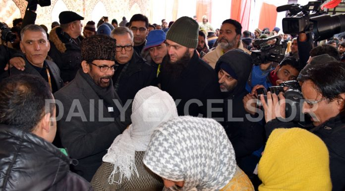 Union Minority Affairs Minister Mukhtar Abbas Naqvi interacting with people in Srinagar on Tuesday. -Excelsior/Shakeel
