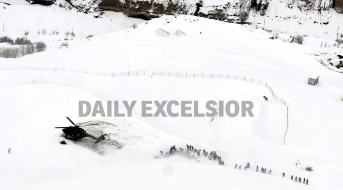 Trapped in snow, trekkers being rescued by Army helicopter in Ladakh area. -Excelsior/Morup Stanzin