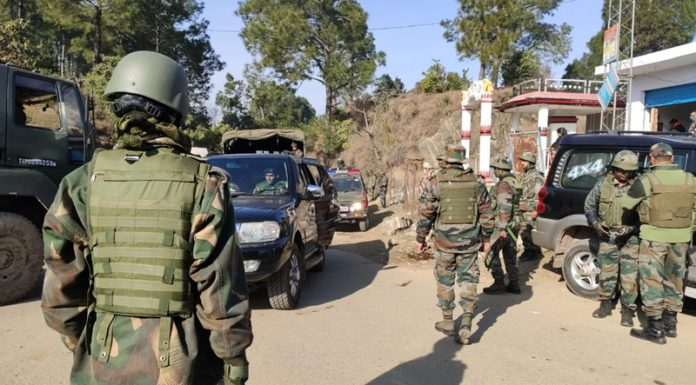 Troops during search operation in Nowshera sector on Wednesday. (Inset) Two Army martyrs.