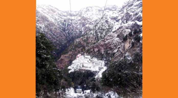 A panoramic view of snow clad Shri Mata Vaishno Devi cave shrine situated in Trikuta Hills of Katra. (UNI)