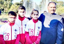 J&K Pencak Silat medallists posing along with LG Girish Chandra Murmu at Raj Bhawan in Jammu.