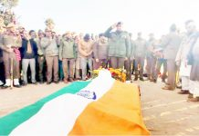 Martyred SPO being paid rich tributes by cops in Uniform in Manjakot on Wednesday. -Excelsior/Gafoor Bhat