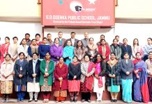 Participants of HoL teachers training work along with resource persons posing for a group photograph after the workshop in Jammu.