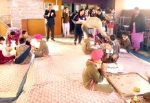Students playing Carrom board in inter-school competition at Shiksha Niketan, Gandhi Nagar, Jammu on Saturday.