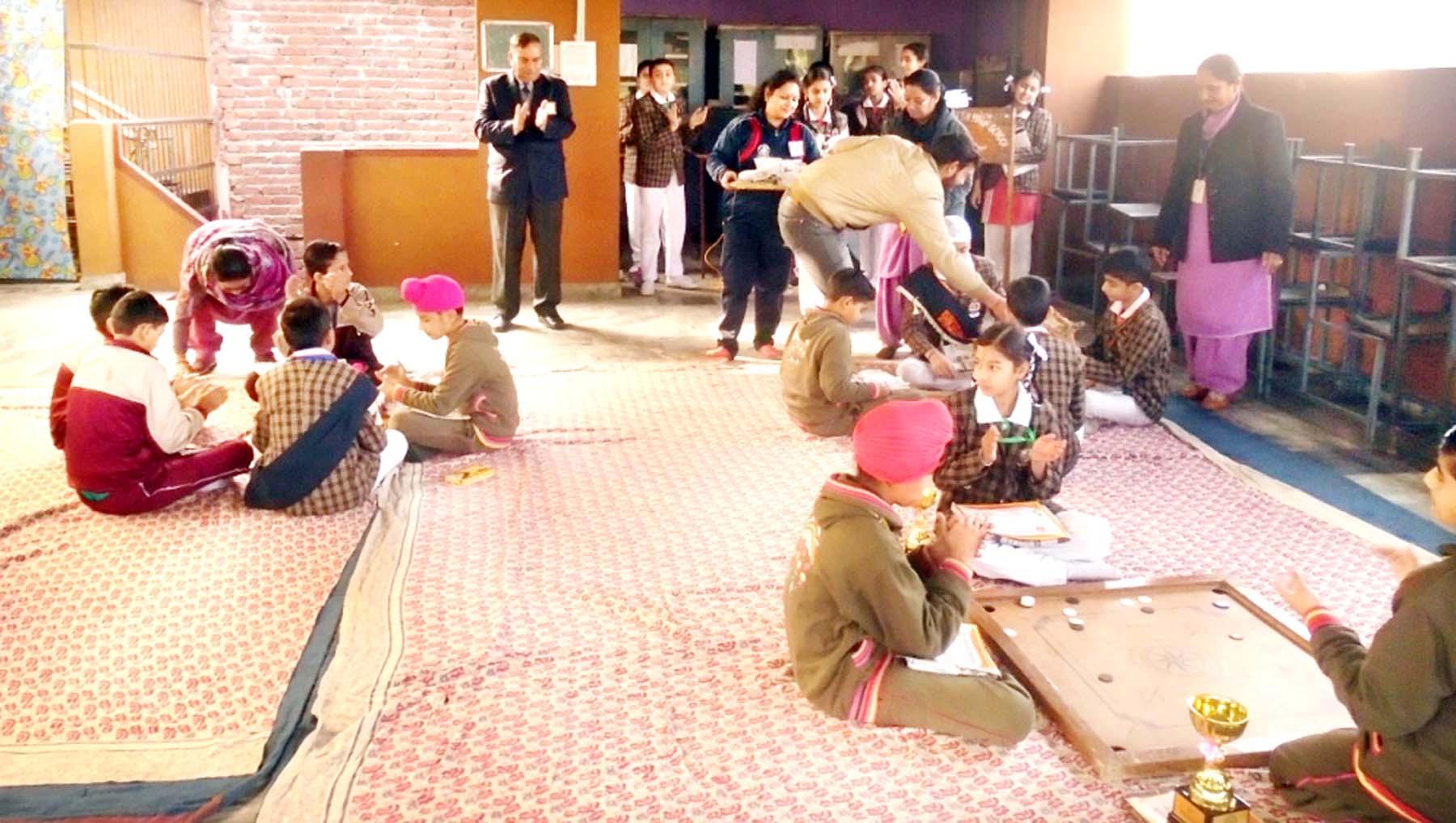 Students playing Carrom board in inter-school competition at Shiksha Niketan, Gandhi Nagar, Jammu on Saturday.